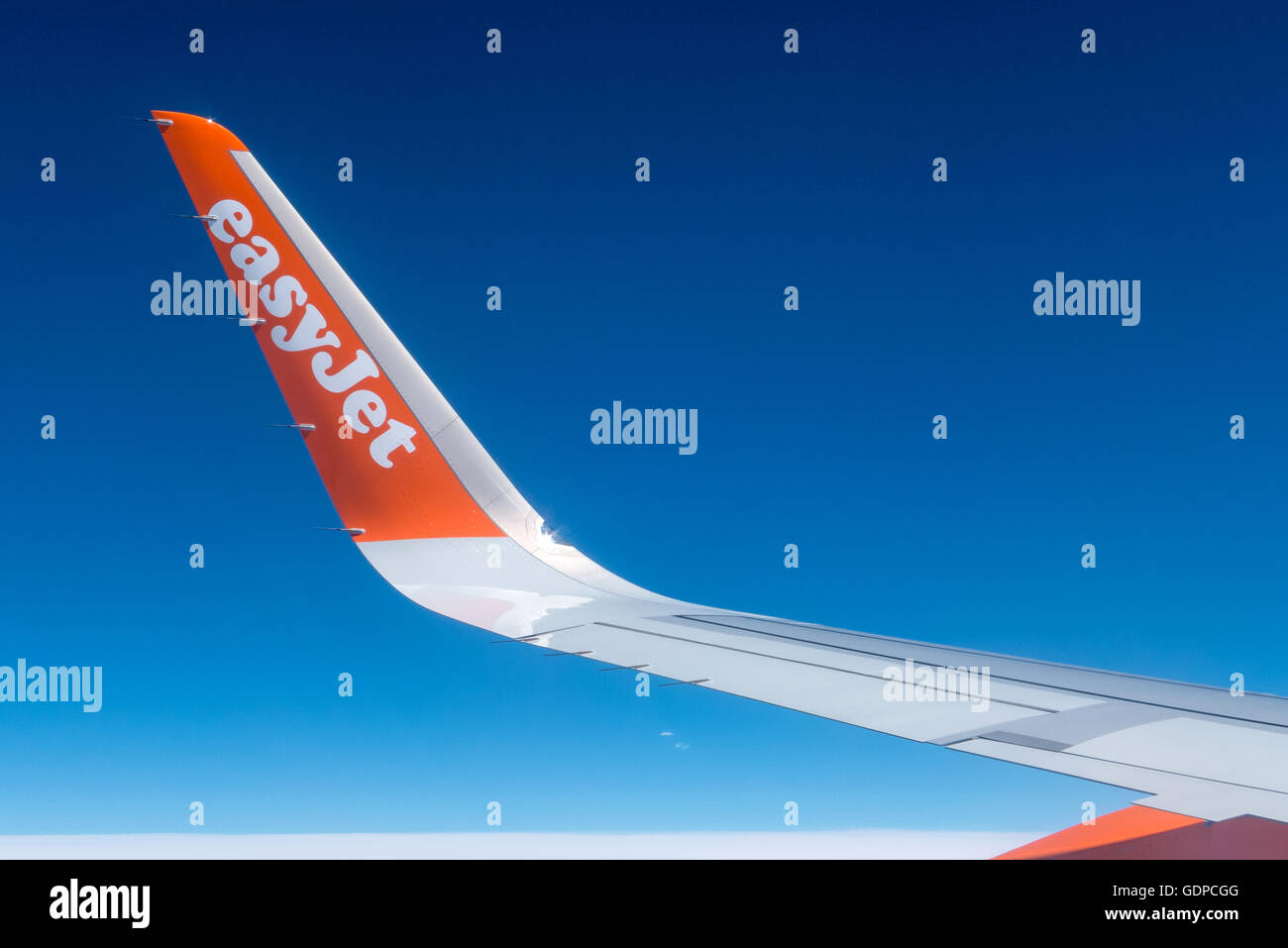 The wingtip of an EasyJet Airbus plane on the way to Spain. - Stock Image