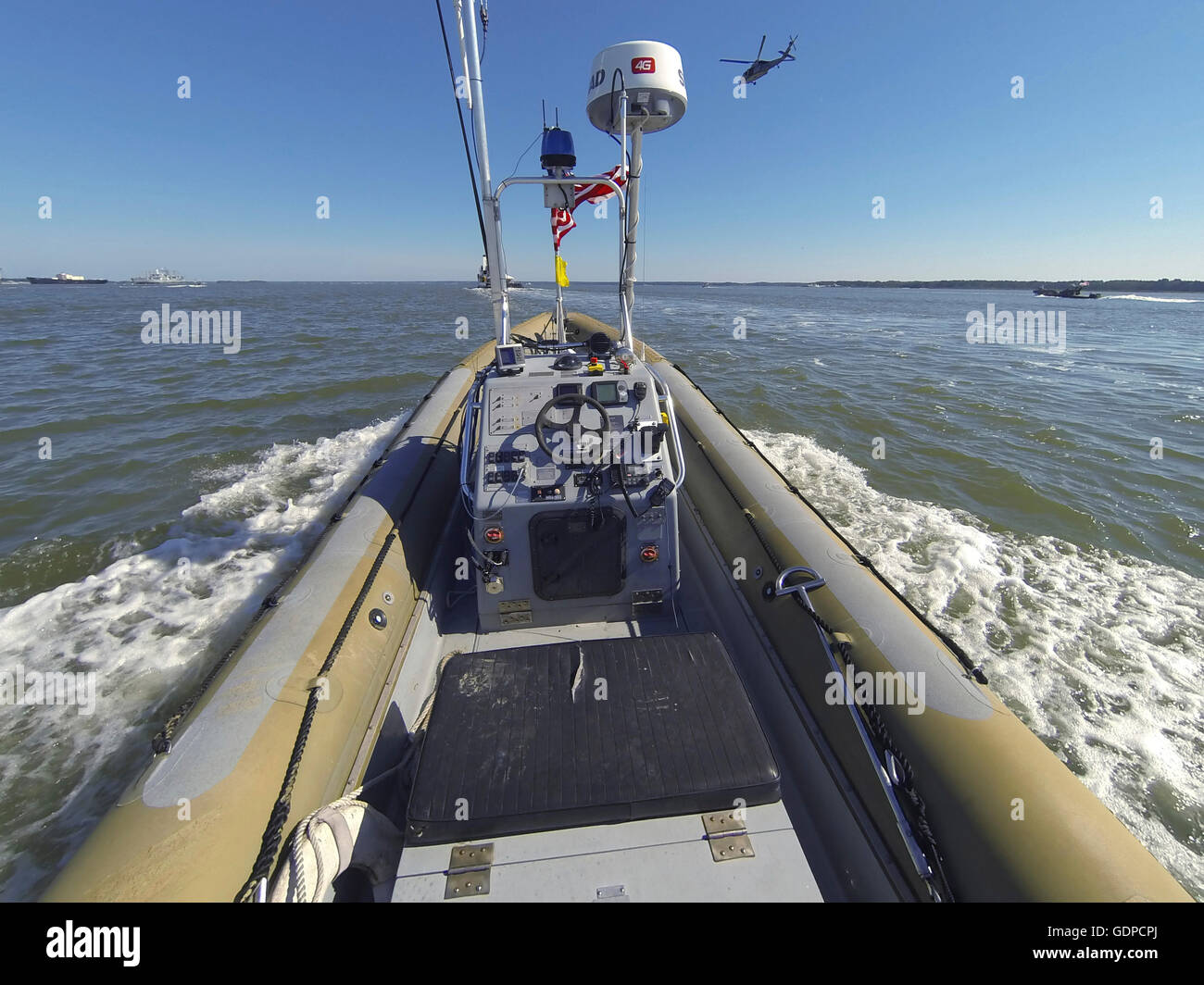 August 14, 2014 - An unmanned seven-meter rigid-hull inflatable boat operates autonomously on the James River in - Stock Image