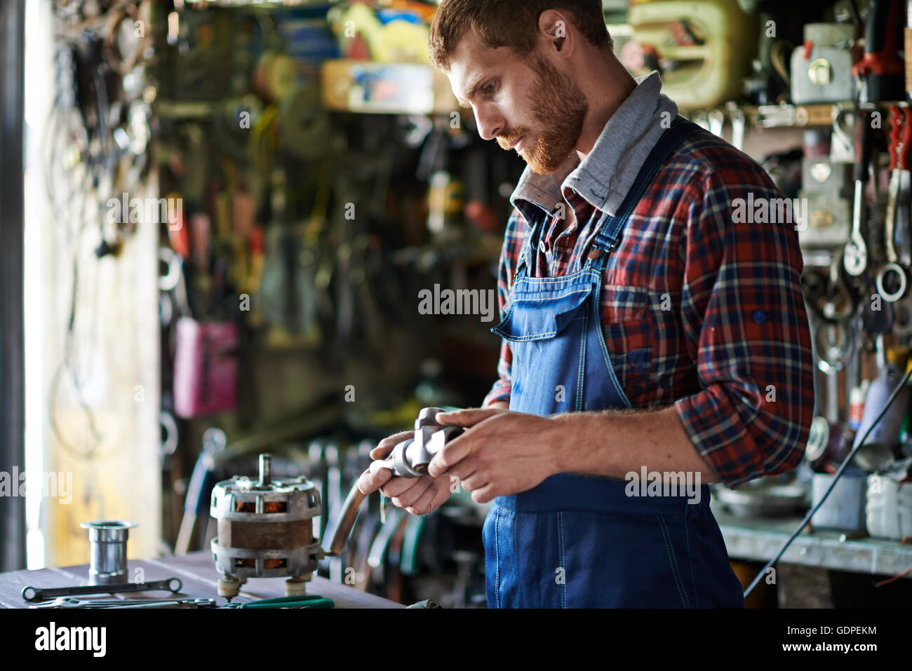 Looking at spare part - Stock Image