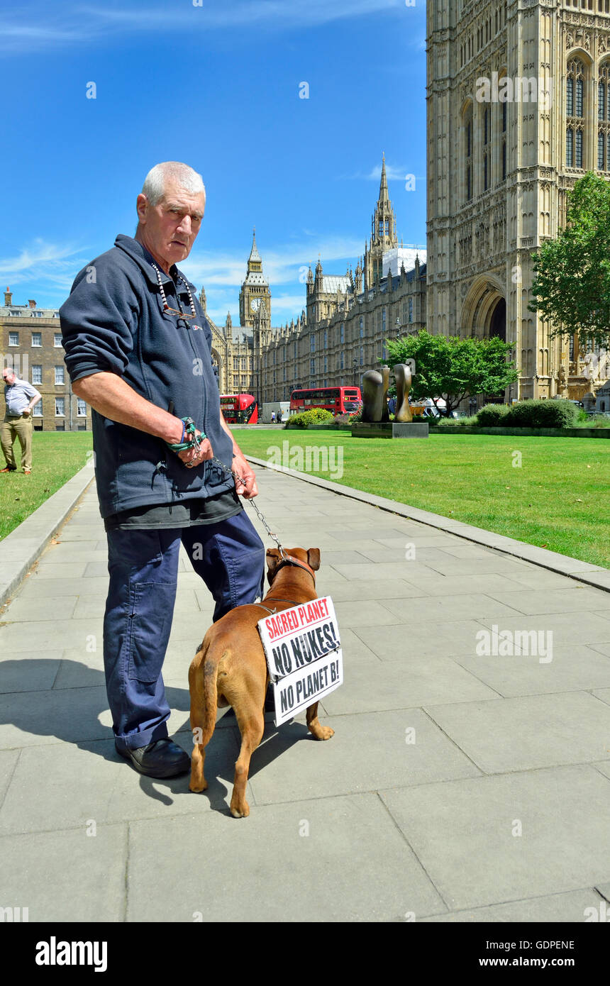 Stuart Holmes, veteran anti-nuclear campaigner with his dog, also called Stuart, outside parliament ... - Stock Image