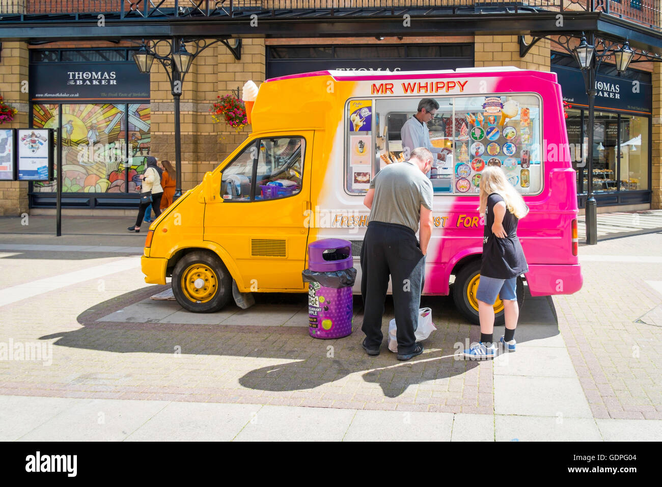 3159902ef9 Man and a girl buying Ice Cream from a traditional Mr Whippy van in Captain  Cook