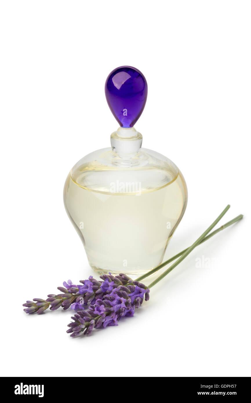 Bottle lavender oil and fresh flowers - Stock Image