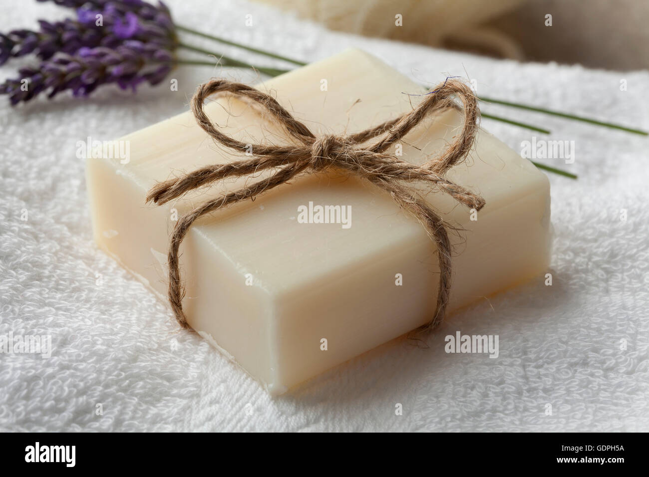 Piece of lavender soap and olive oil - Stock Image