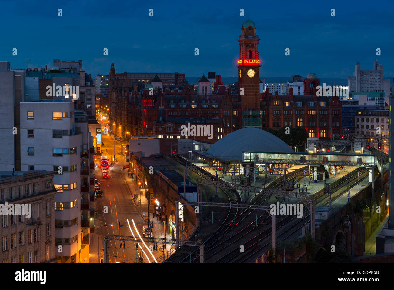 Manchester skyline with road traffic and trains near Oxford Road station by Whitworth Street West in the city centre - Stock Image