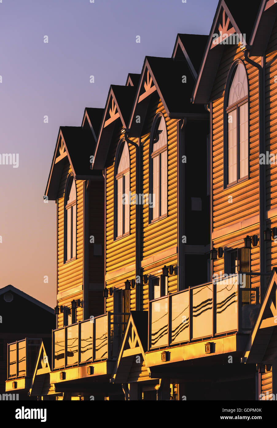 Evening sun shining on a row of townhouses or condo - Stock Image