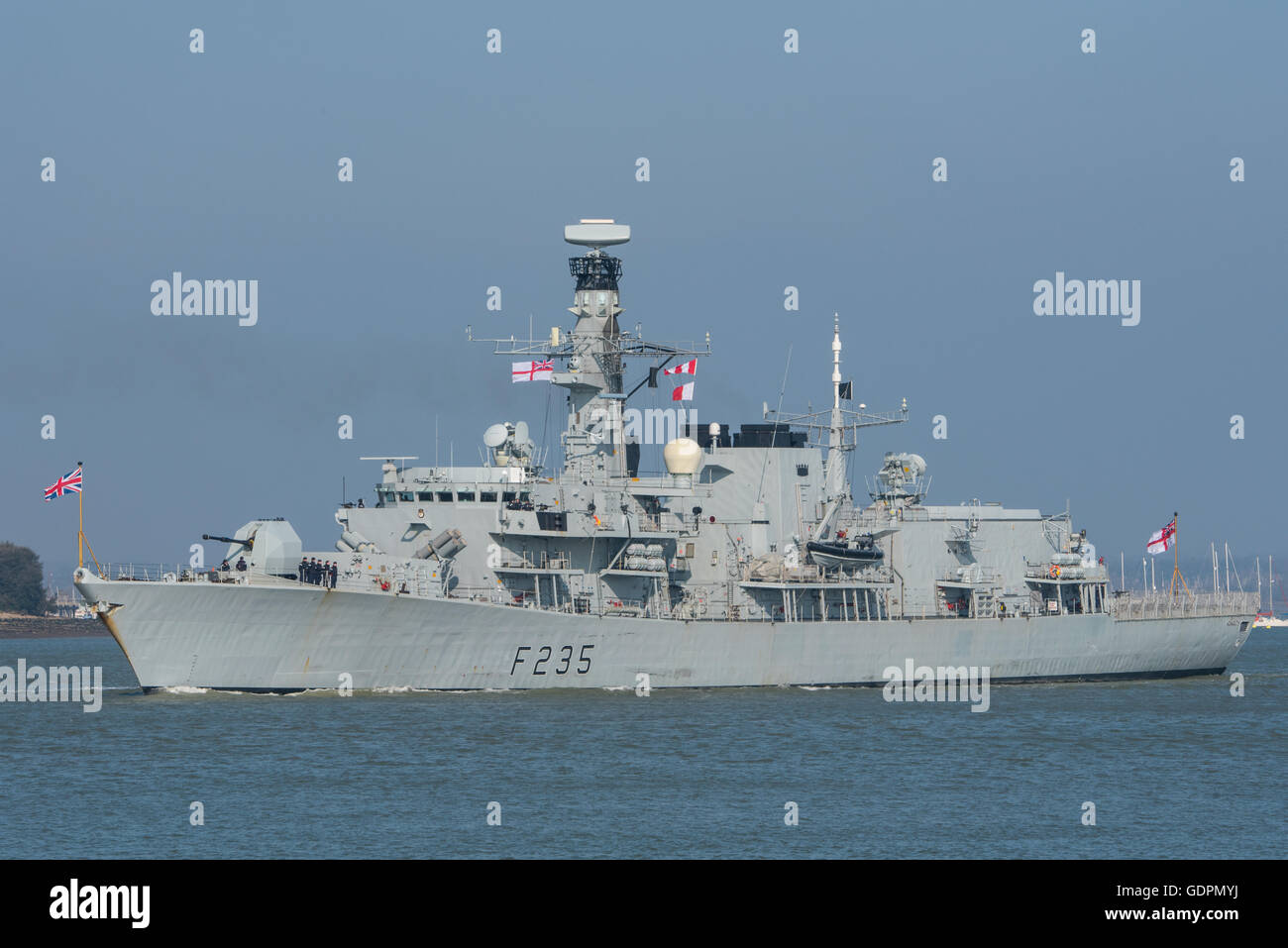 The British Royal Navy warship HMS Monmouth (F235) a Type 23 frigate leaving Portsmouth, UK, on Commonwealth Day, - Stock Image