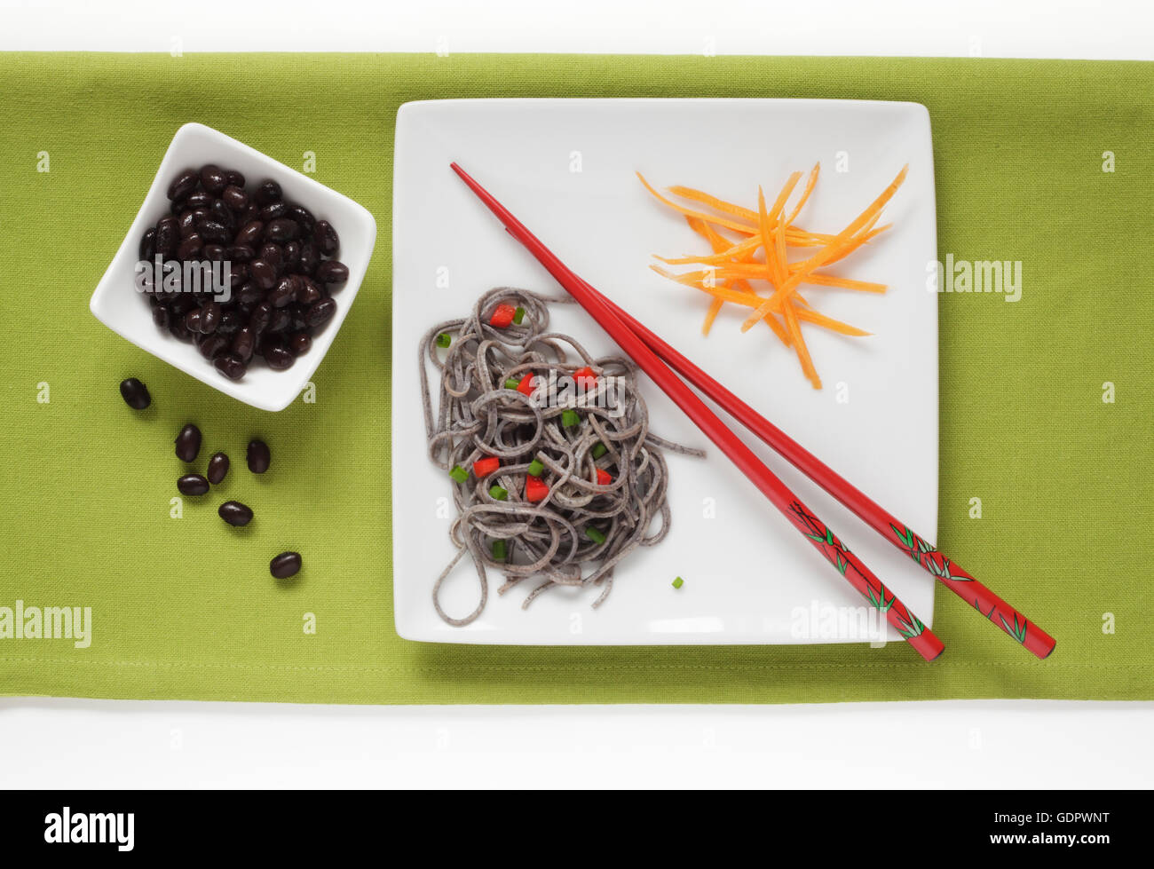 Black Bean and Black Bean Spaghetti garnished with Carrots - Stock Image