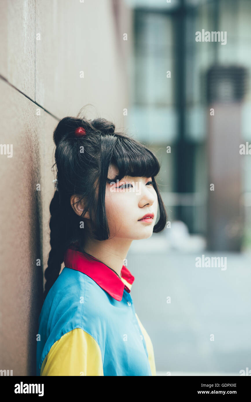 Half length portrait of young beautiful asian millennial woman outdoor in the city, overlooking serene - make up, - Stock Image