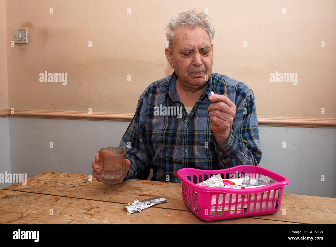 Elderly man with type 2 diabetes taking Metformin - Stock Image