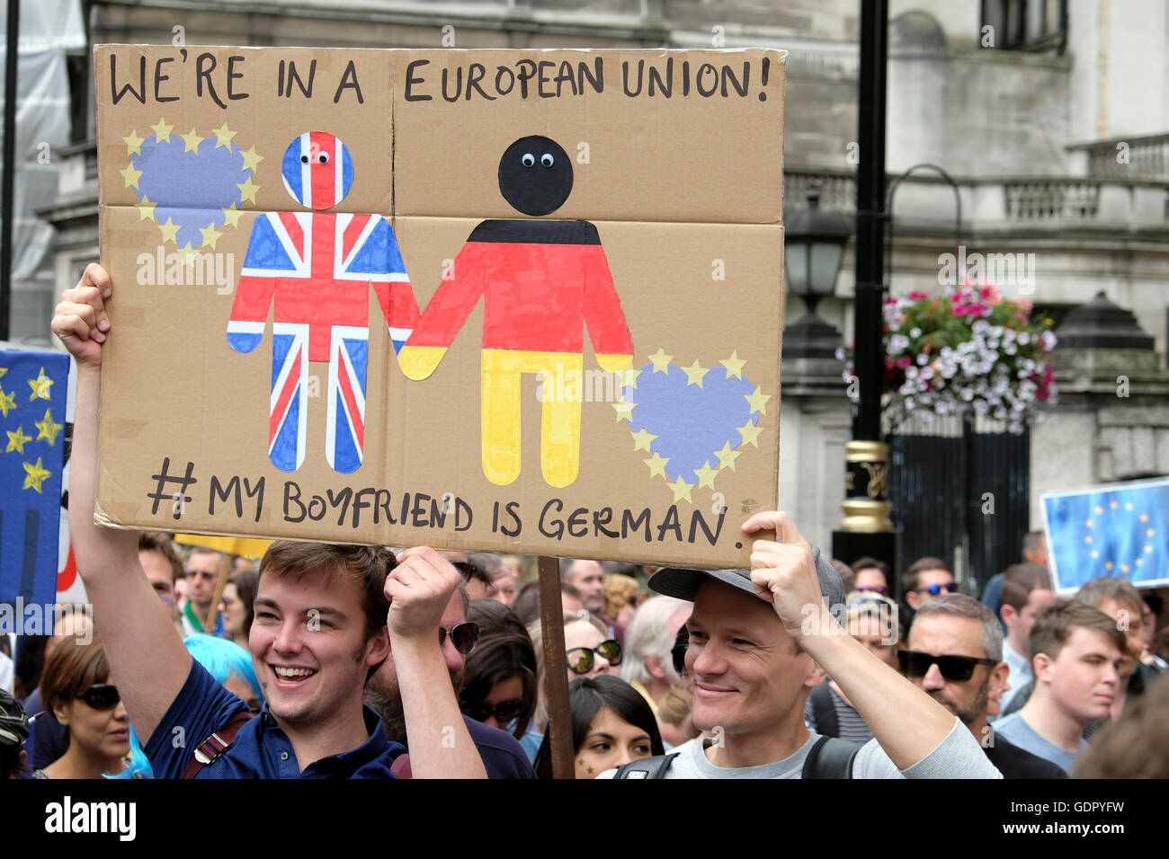Gay couple with placard at the  'March for Europe'  anti Brexit demonstration to remain in the EU, London - Stock Image