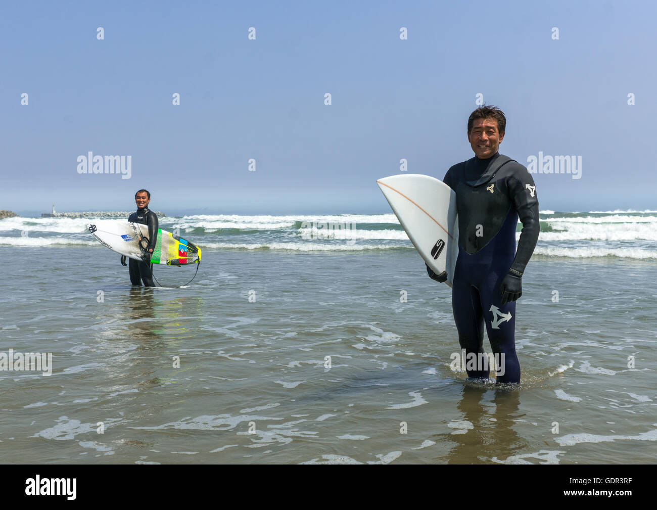 Japanese surfers in the contaminated area after the daiichi nuclear power plant irradiation, Fukushima prefecture, - Stock Image