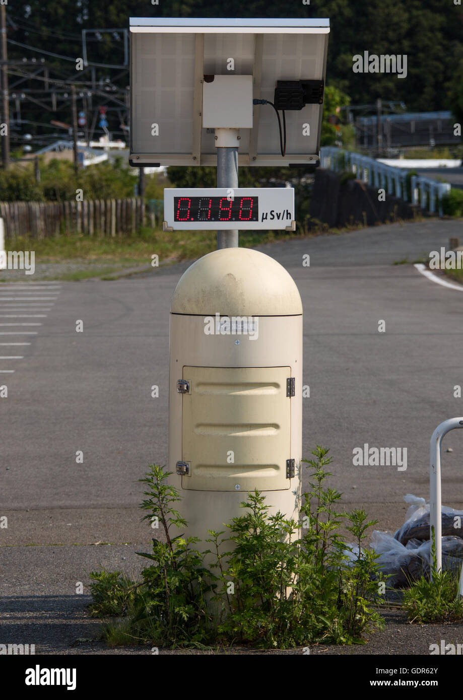 A radiation dosimeter placed in a highly contaminated area after the daiichi nuclear power plant irradiation, Fukushima - Stock Image