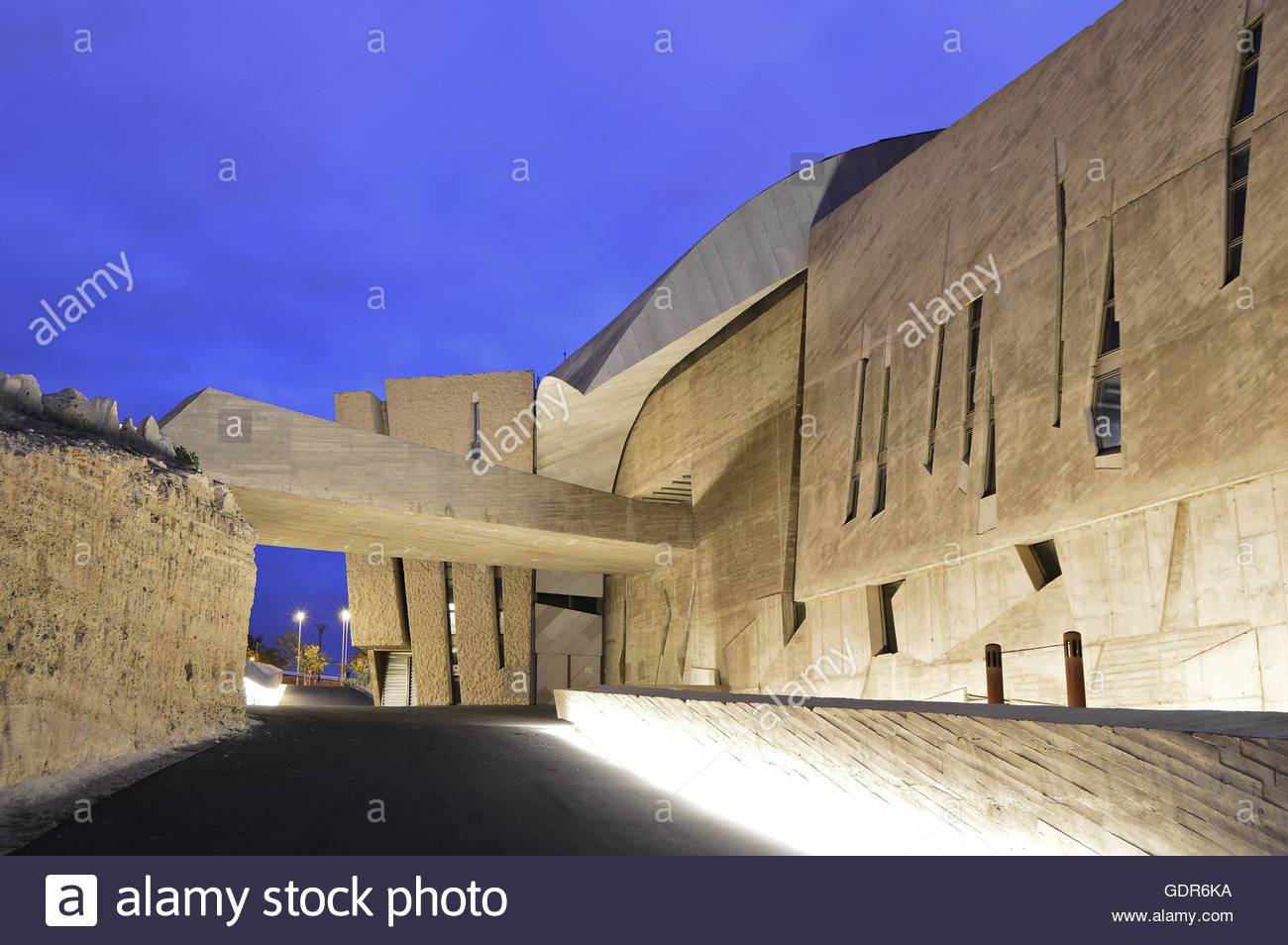 Magma Arts and Congress Center, modern stone and concrete structure at dusk, Costa Adeje Tenerife Canary Islands - Stock Image