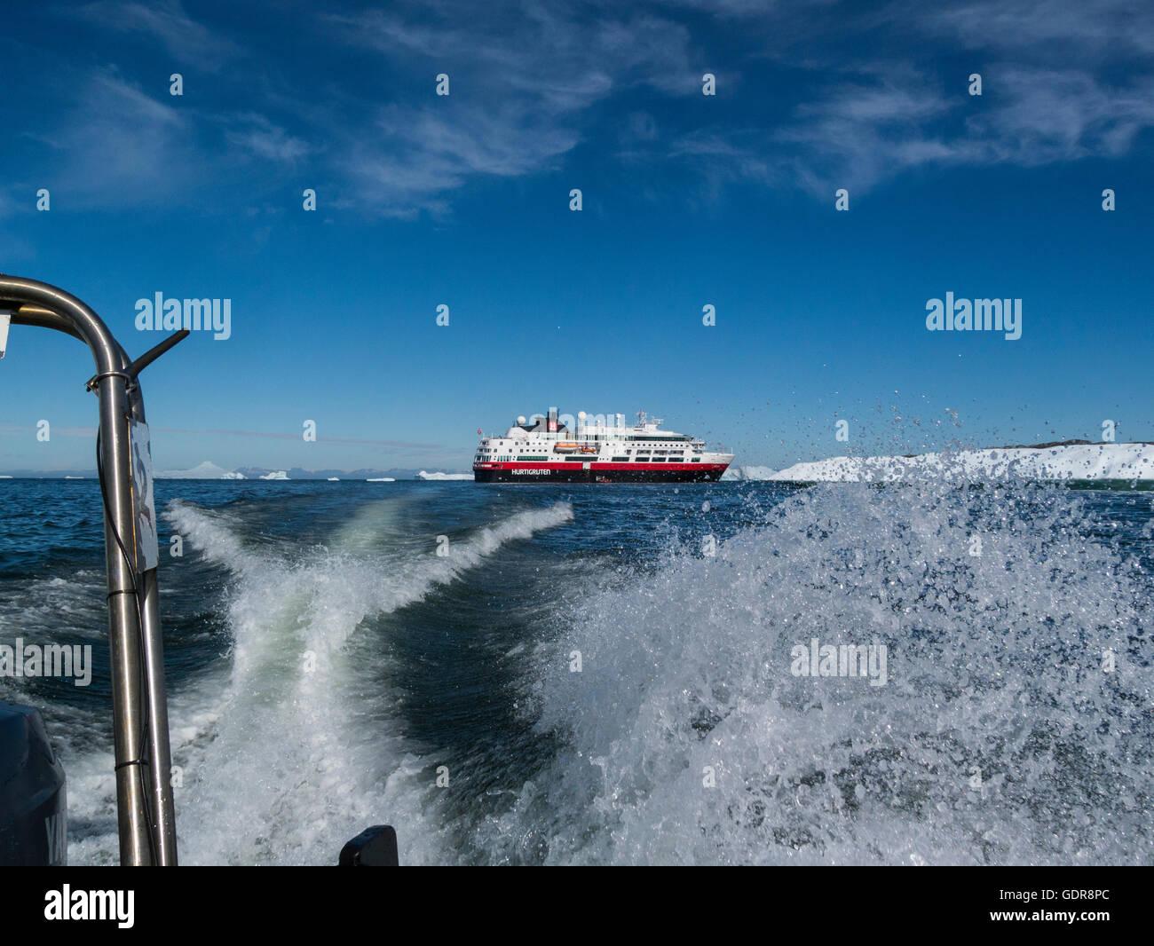 Polar Circle boat leaving MV Fram cruise ship to transfer passengers to shore from ship moored in Disko Bay Greenland Stock Photo