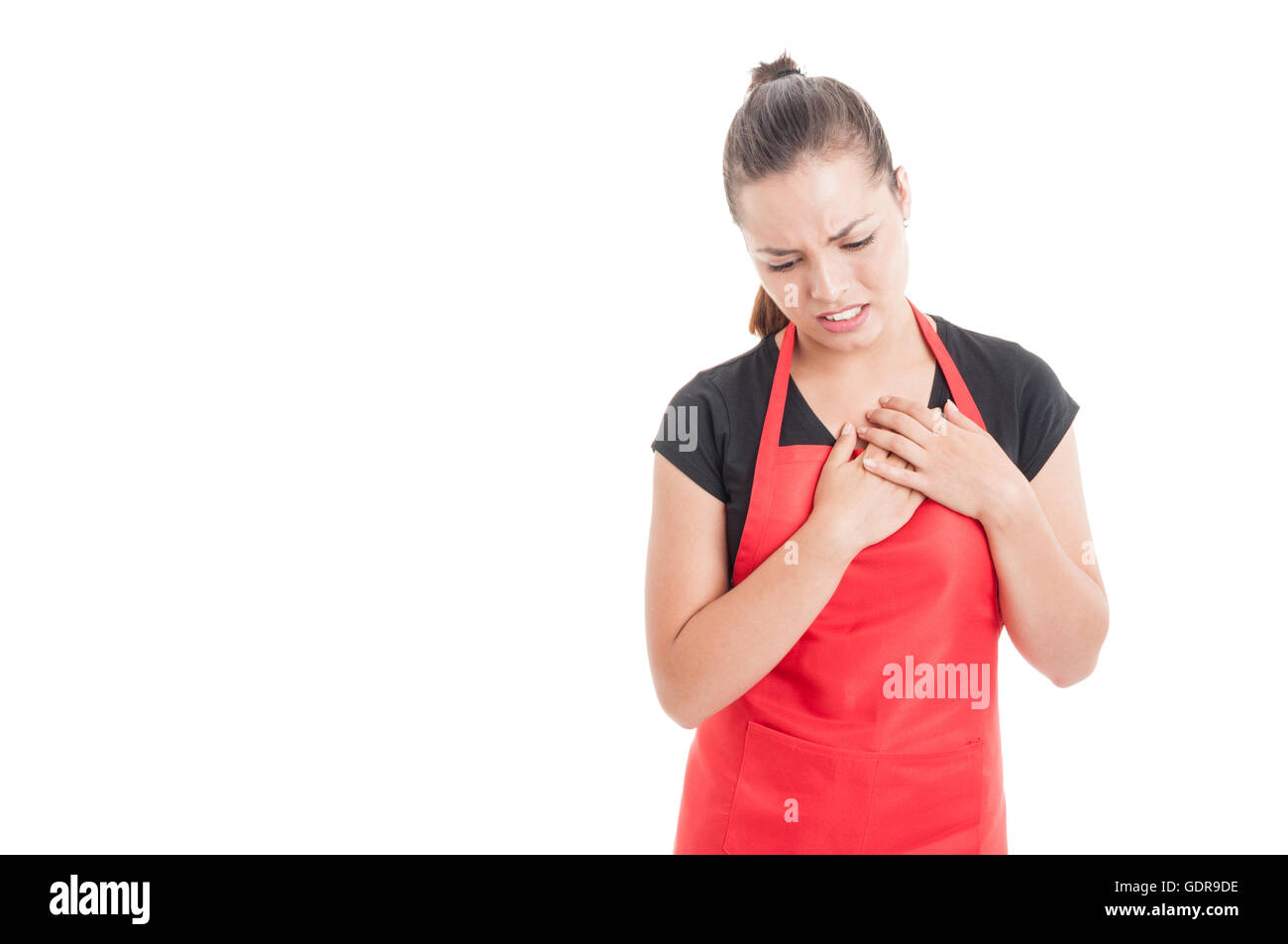 Stressed young employee having chest pain as cardiac disease concept isolated on white background with copy space - Stock Image