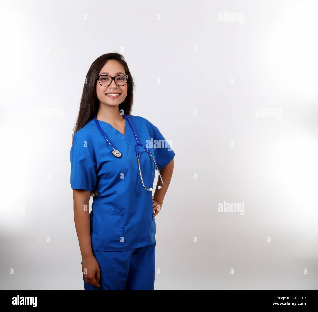 A latina nurse in blue scrubs. Stock Photo
