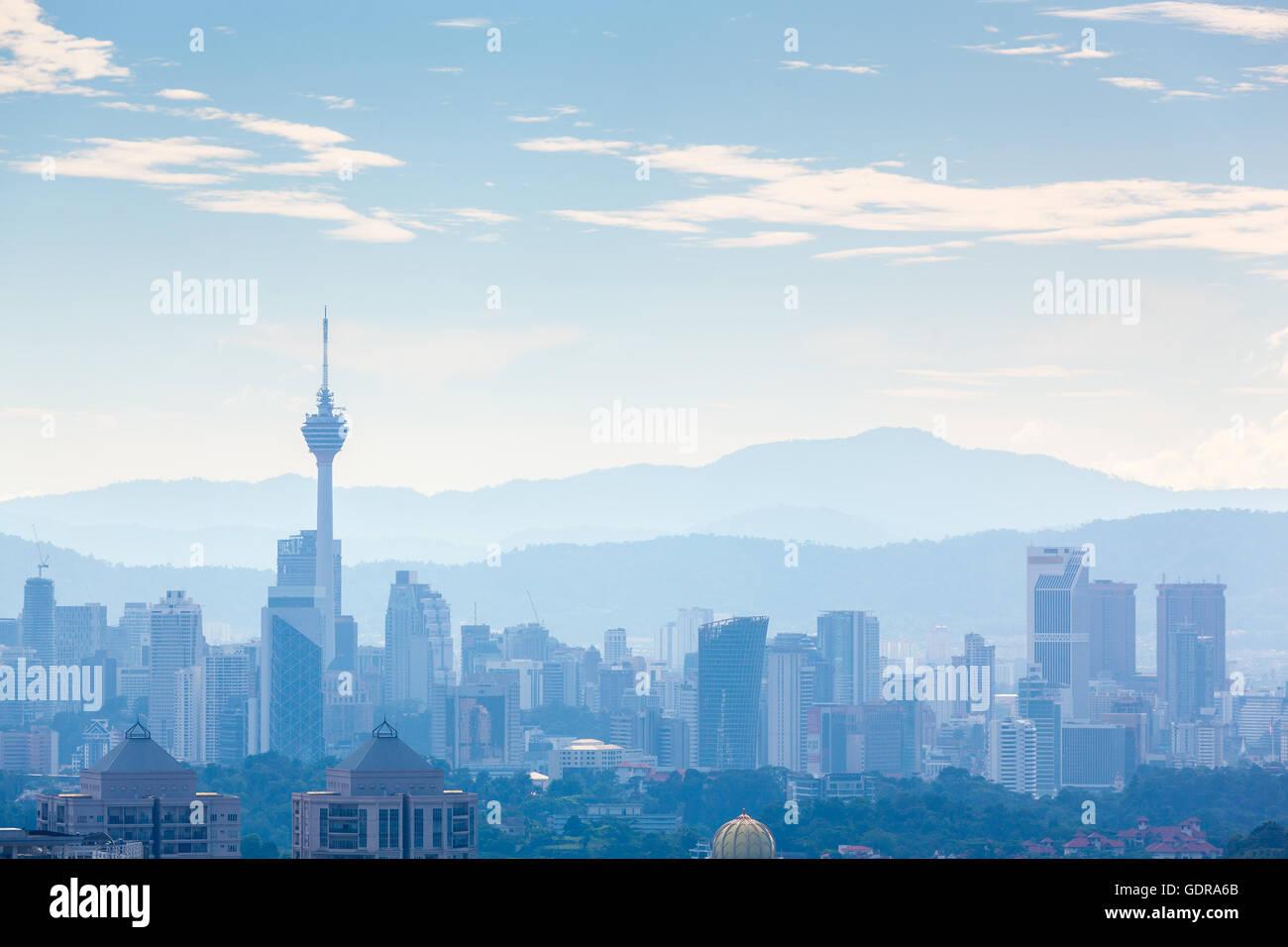 Kuala Lumpur cityscape at noon, hazy day, west of Kuala Lumpur - Stock Image