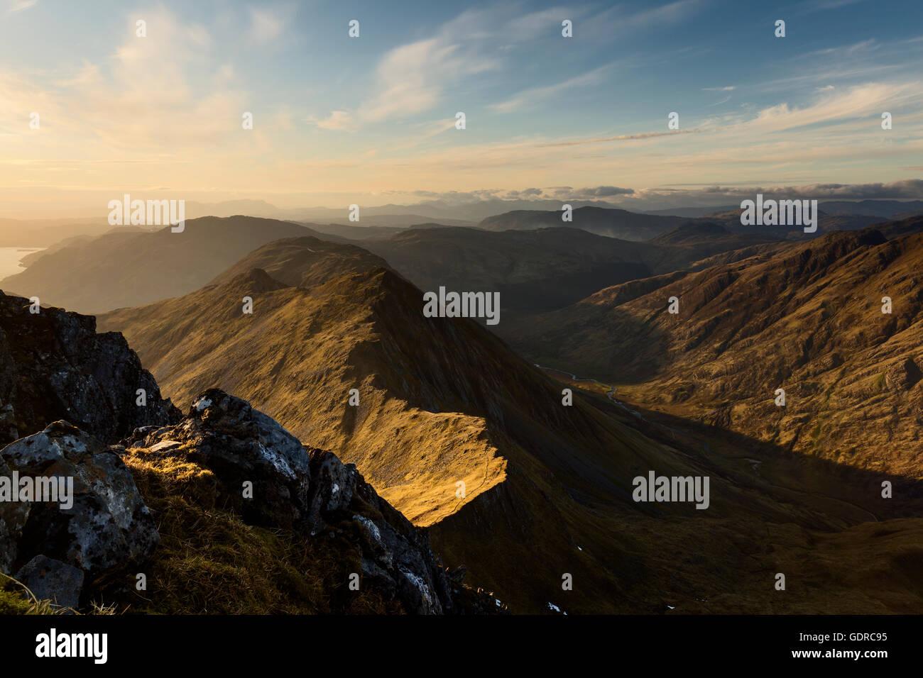 Sgurr nan Saighead sidelit by the setting sun (Five Sisters of Kintail) - Stock Image