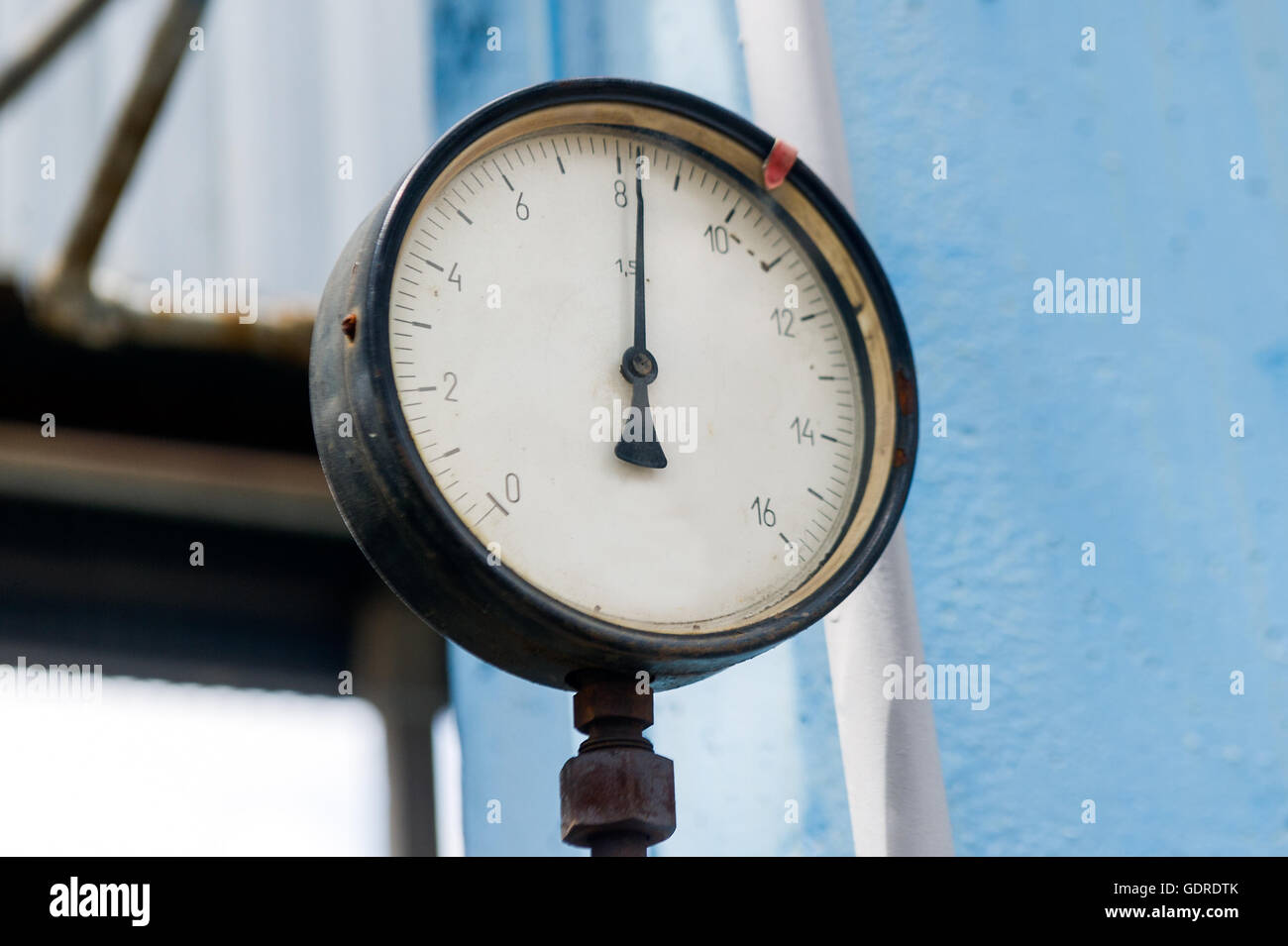 Pressure meter in natural gas processing plant in bright sunny summer day - Stock Image