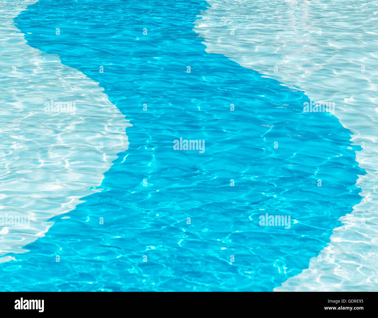 Blue deep strip going through a crystal clear swimming pool ideal for copy space and posters - Stock Image