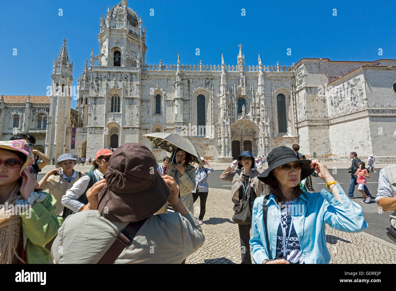 Japanese tourists organized before the Jerónimos Monastery, UNESCO World Heritage Site, Lisbon, District of - Stock Image