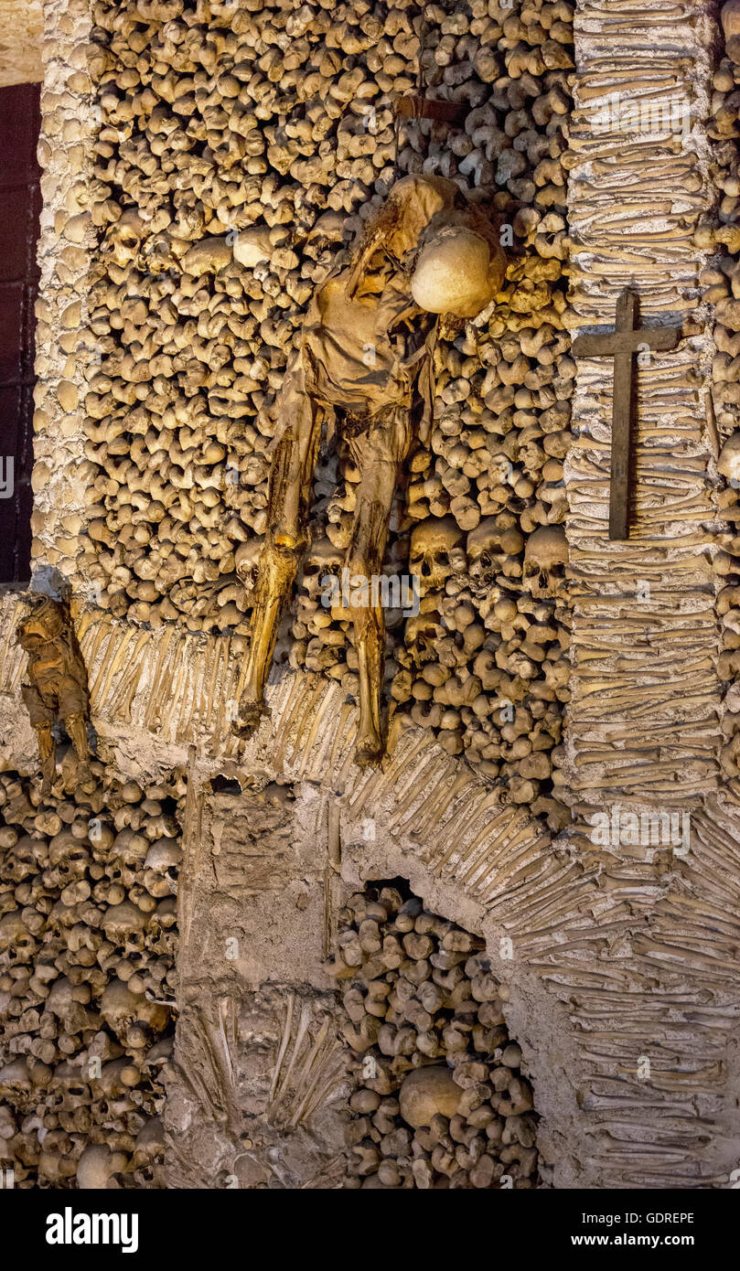 piled bones in the ossuary, Capela dos ossos parede, chapel of bones, bone chapel, ossuary in Évora, Évora - Stock Image