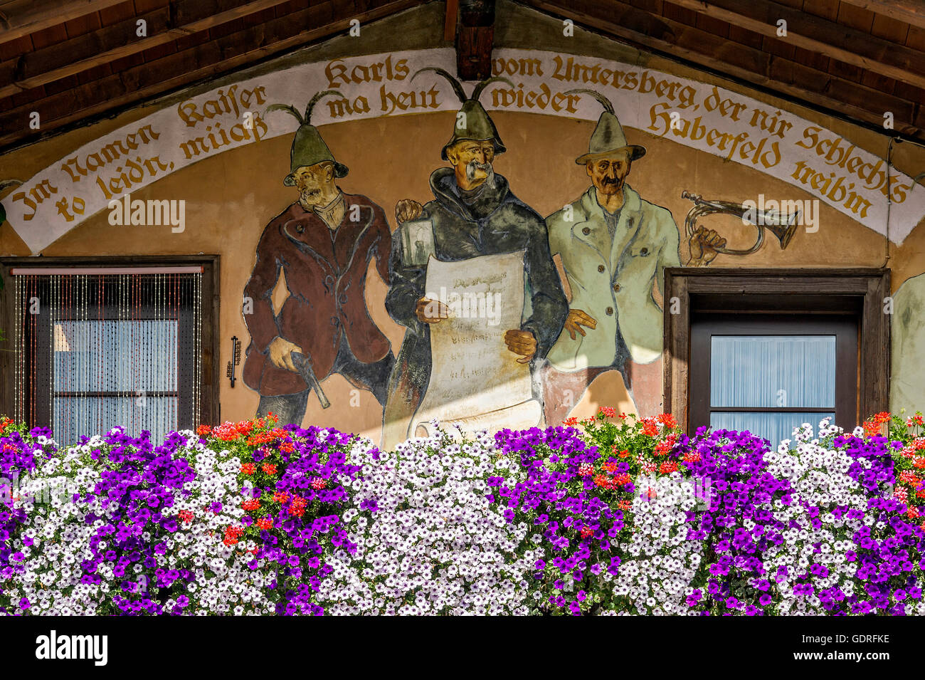 Farmhouse gable with Lüftlmalerei wall paintings and floral decoration, Miesbach, Upper Bavaria, Bavaria, Germany - Stock Image