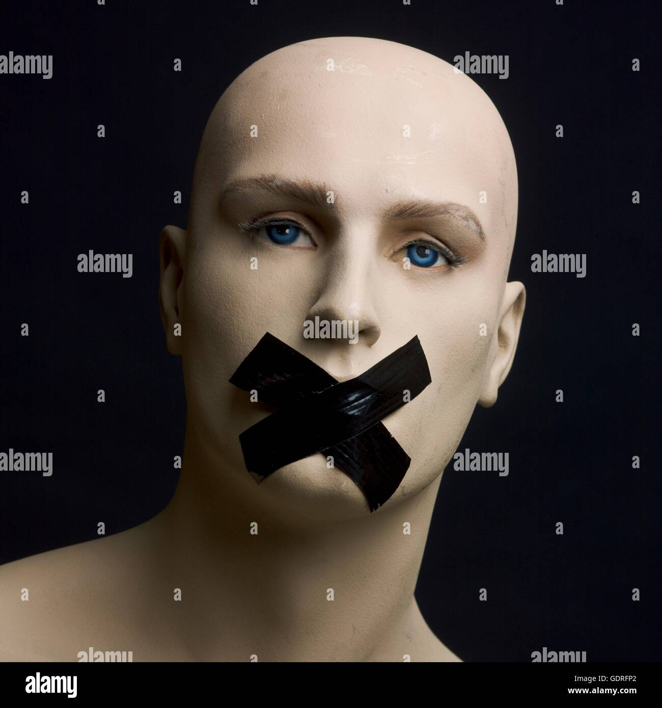 Dummy, mannequin, tape over mouth Stock Photo