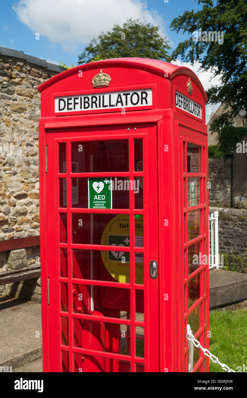 A defibrillator within a telephone kiosk. Waddington , Lancashire, England, UK - Stock Image