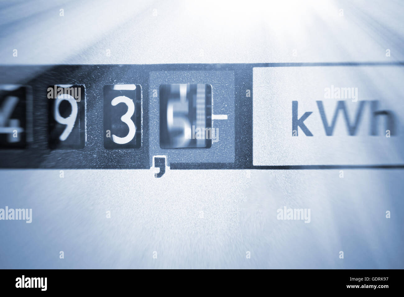 Electric meter with light rays - Stock Image