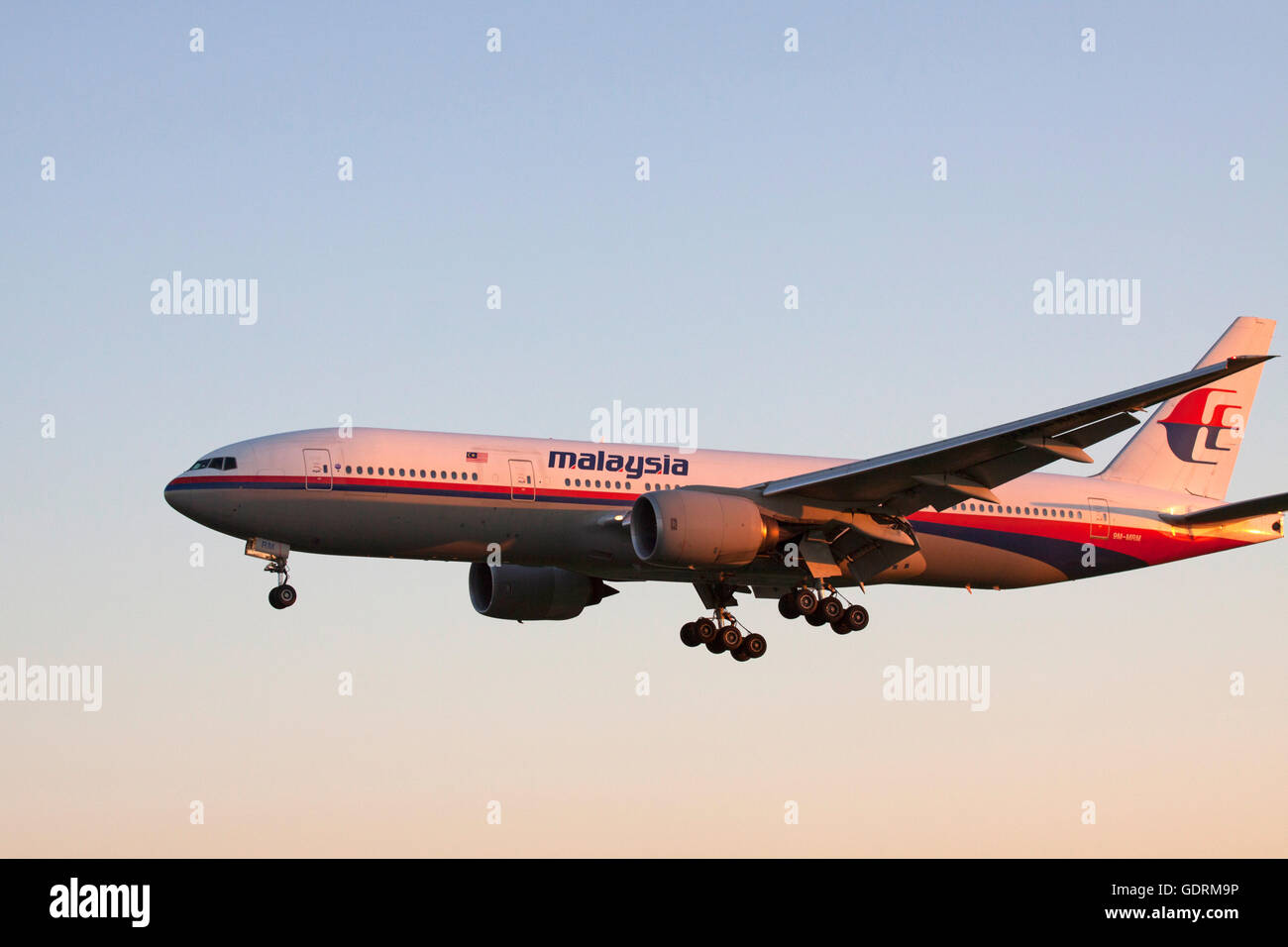 AMSTERDAM, THE NETHERLANDS - SEPTEMBER 30, 2015  Boeing 777 from malaysia airlines will land on the runway shining - Stock Image