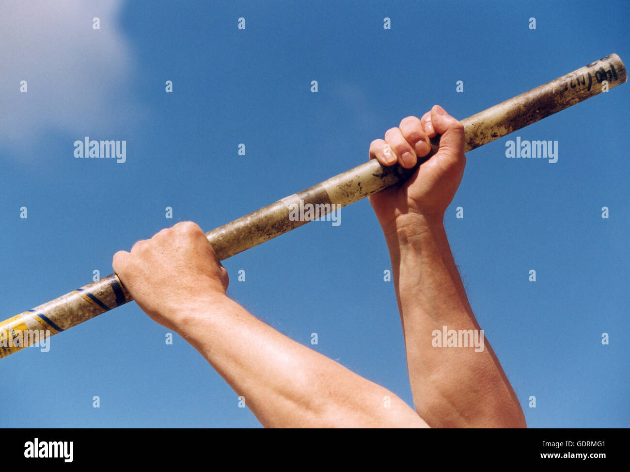 Pole vaulter holding his rod - Stock Image