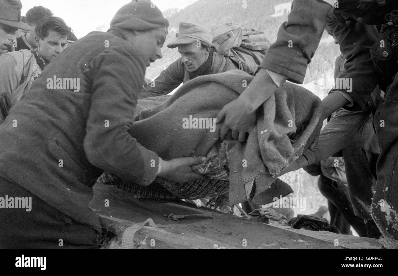 Rescue team saving an avalanche victim at Blons, 1954 - Stock Image