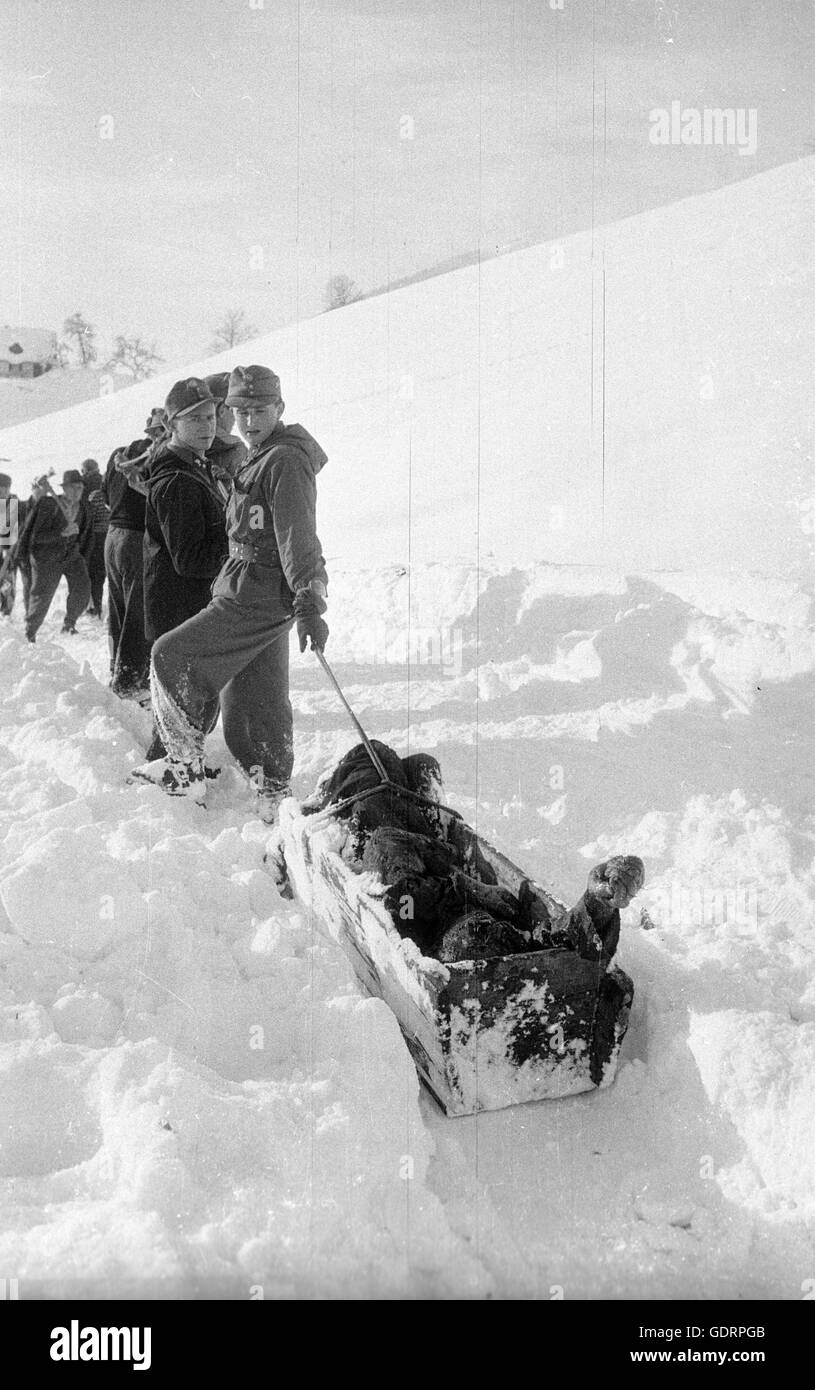 Rescue team with saved victim after the avalanches at Blons, 1954 - Stock Image
