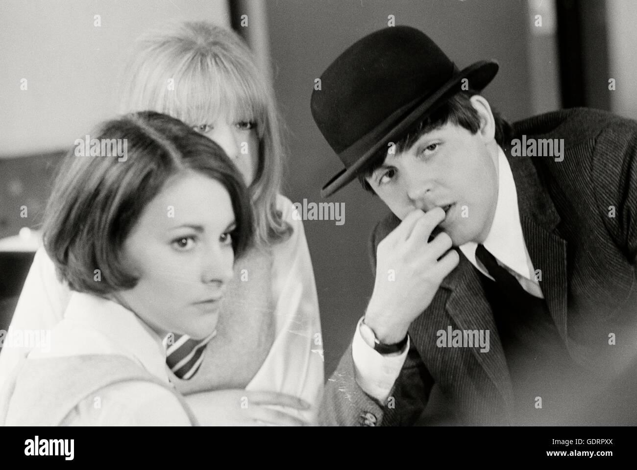 Paul McCartney with Prudence Bury and Pattie Boyd playing school girls on a Hard Days Night Train. - Stock Image