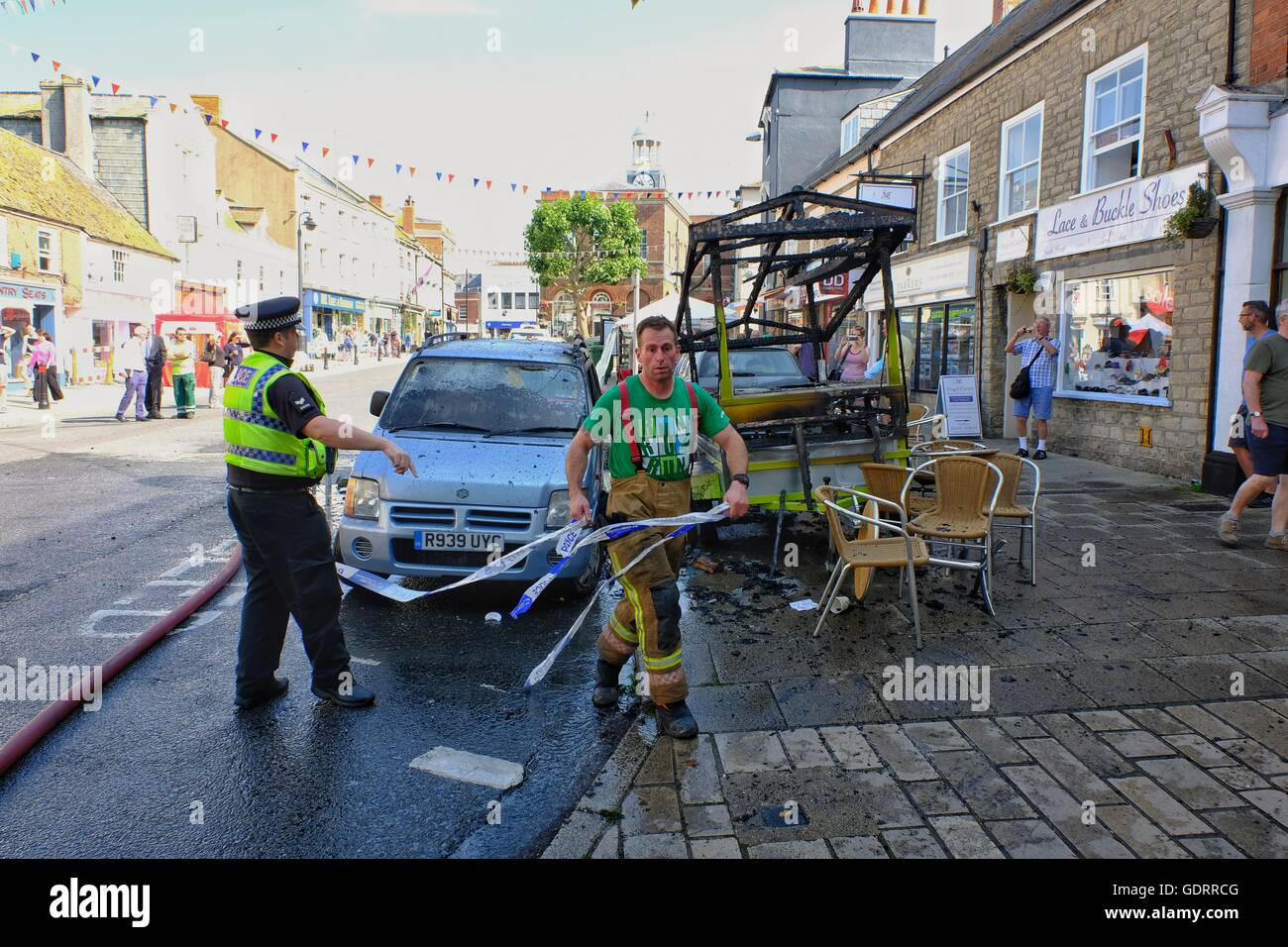 Bridport, Dorset, UK. 20 July 2016. Bridport's crowded historic Wednesday market was closed when a market stall - Stock Image