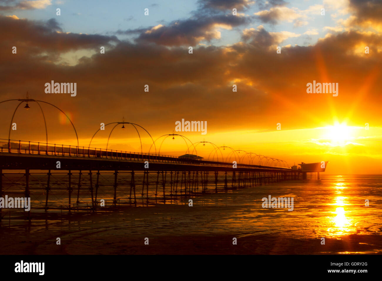 Southport, Merseyside, UK. 20th July, 2016. UK Weather. A stunning sunset nestles over Southport Pier after a day - Stock Image