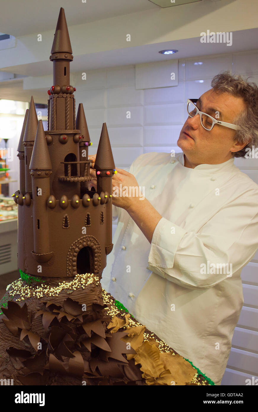 Christian Escriba making a`Mona´, typical chocolate cake of Pascua´s monday, the godfather - Stock Image