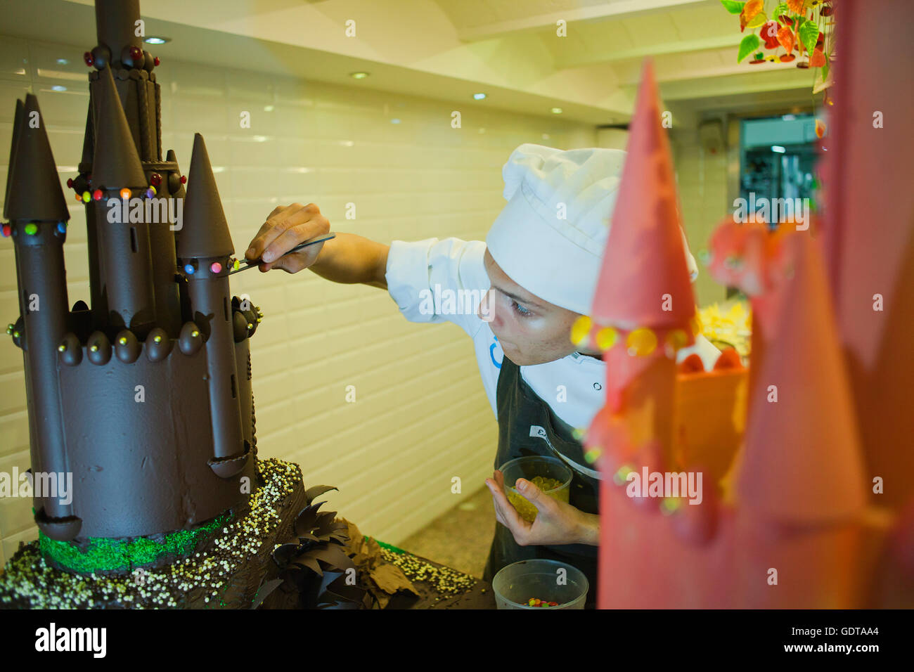Baker making a`Mona´, typical chocolate cake of Pascua´s monday, the godfather gives his godson,catalan - Stock Image