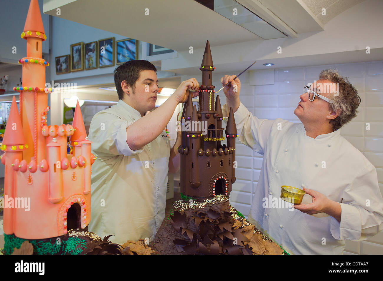 Christian Escriba and his son making a `Mona´, typical chocolate cake of Pascua´s monday, the godfather - Stock Image