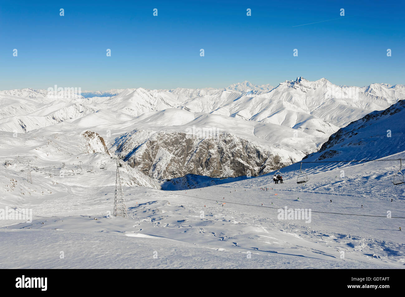 Pistes and ski lifts with in the 'Mont Blanc' in background, winter time, ski resort 'Les Deux Alpes, - Stock Image