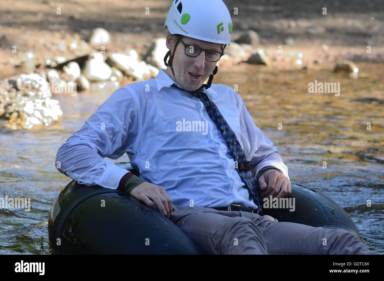 Tube to Work Day: a unique event during  which residents ride inner tubes and other flotation devices on Boulder Stock Photo