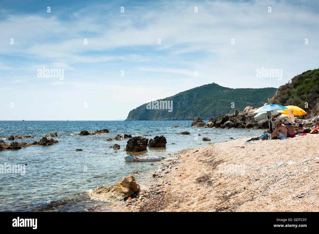 Small beach near Porto Santo Stéfano, Tuscany, province Maremma, Italy - Stock Image