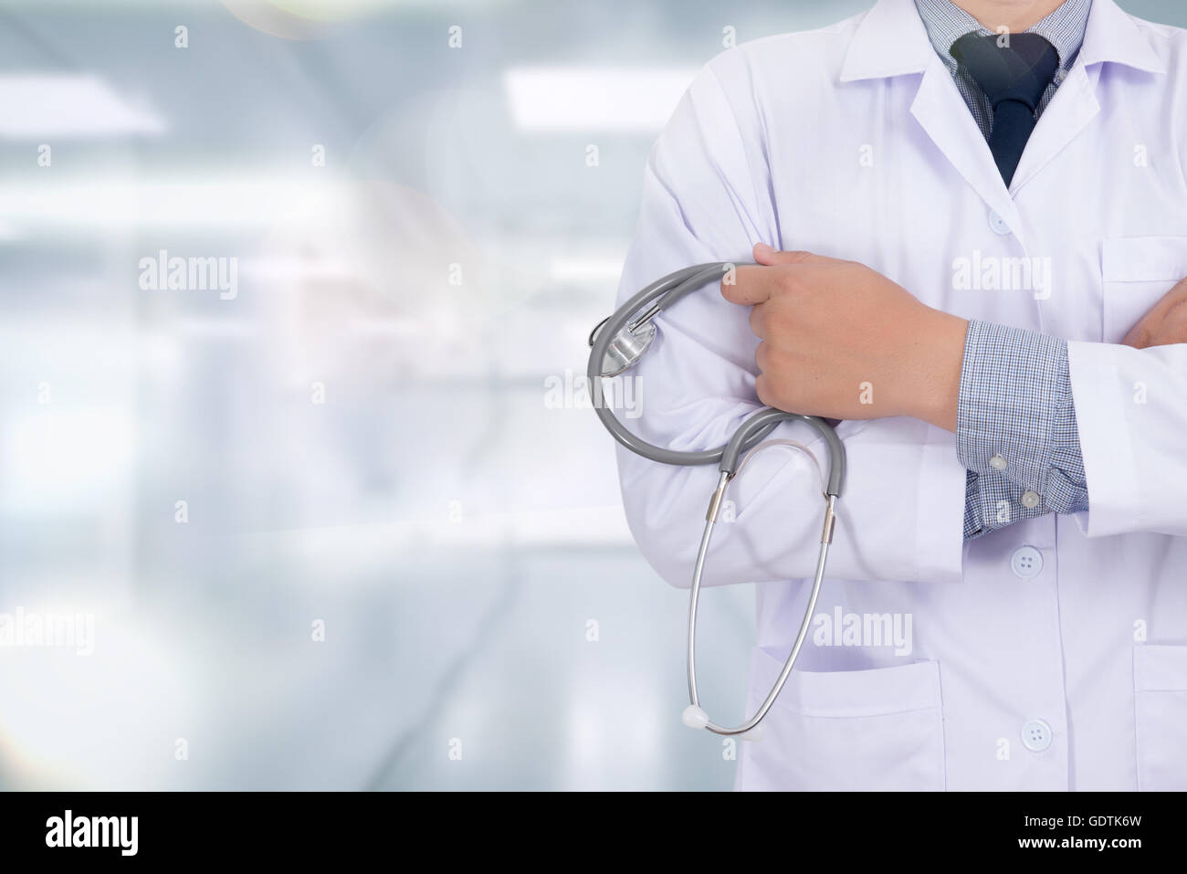 doctor working with abstract blurry bokeh background as concept, success smart medical - Stock Image