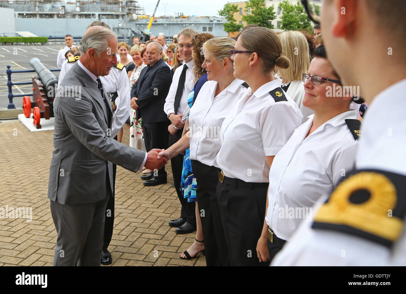 The Prince of Wales, Admiral of the Fleet, meets naval personnel during a visit to Her Majesty's Naval Base - Stock Image