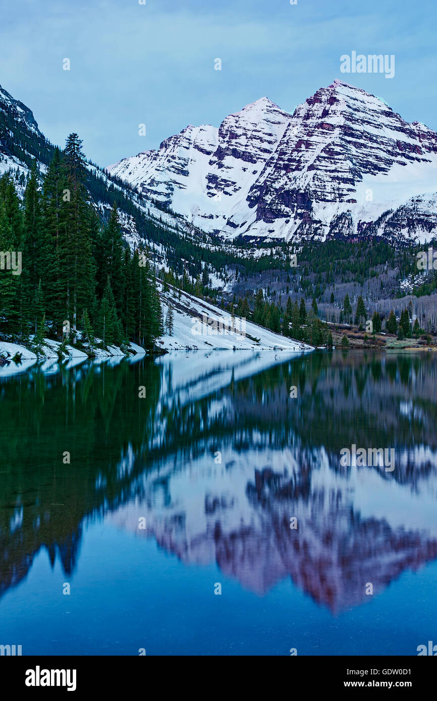 Maroon Bells under snow and Maroon Lake, White River National Forest, Aspen, Colorado USA - Stock Image