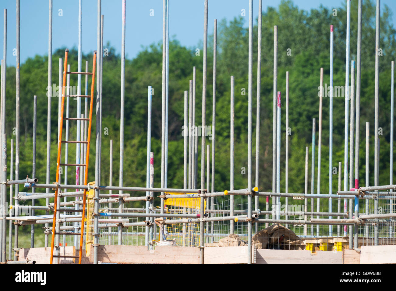 Scaffolding poles on a house construction site in Shifnal, Shropshire, England, UK. - Stock Image