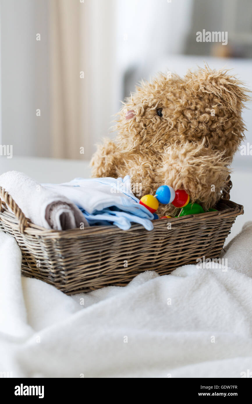 close up of baby clothes and toys for newborn - Stock Image