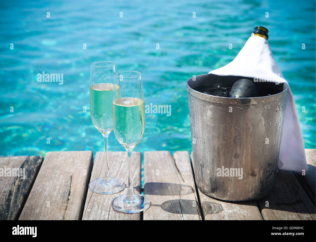 Champagne Bottle In Ice Bucket And Champagne Glasses By Swimming Pool Stock Photo 111808296 Alamy