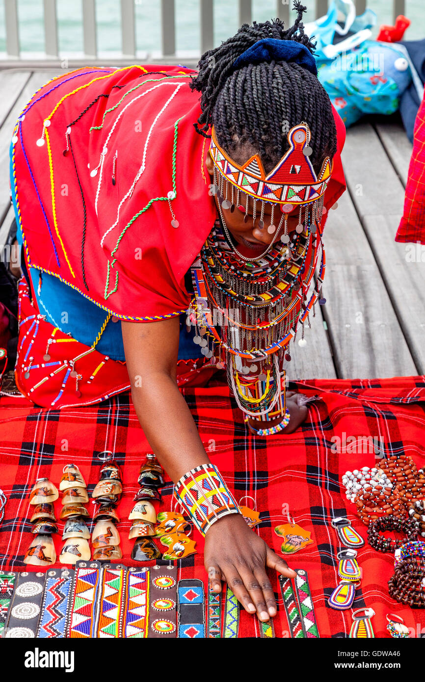 An African Woman In Traditional Costume Selling Handicrafts On Stock